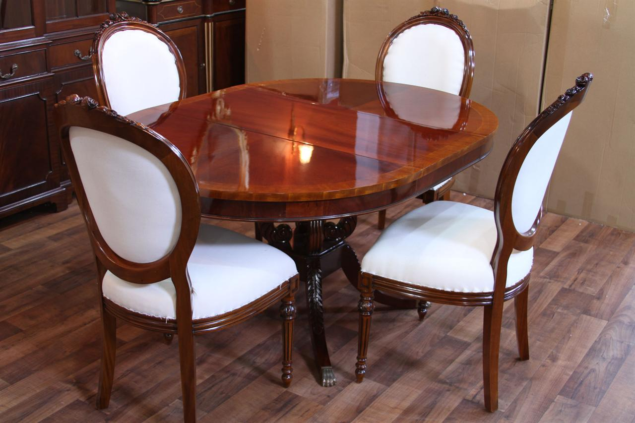 Round mahogany pedestal dining table 44 reproduction for Antique dining room tables