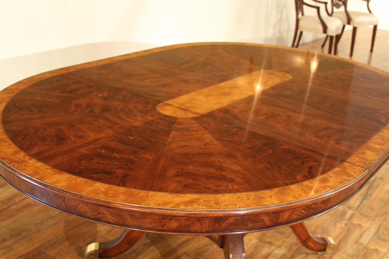48 Inch Round To Oval Walnut And Yew Banded Dining Table