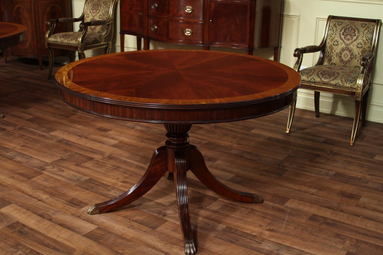 Round mahogany dining table with leaf four leg reeded for Dining room round table