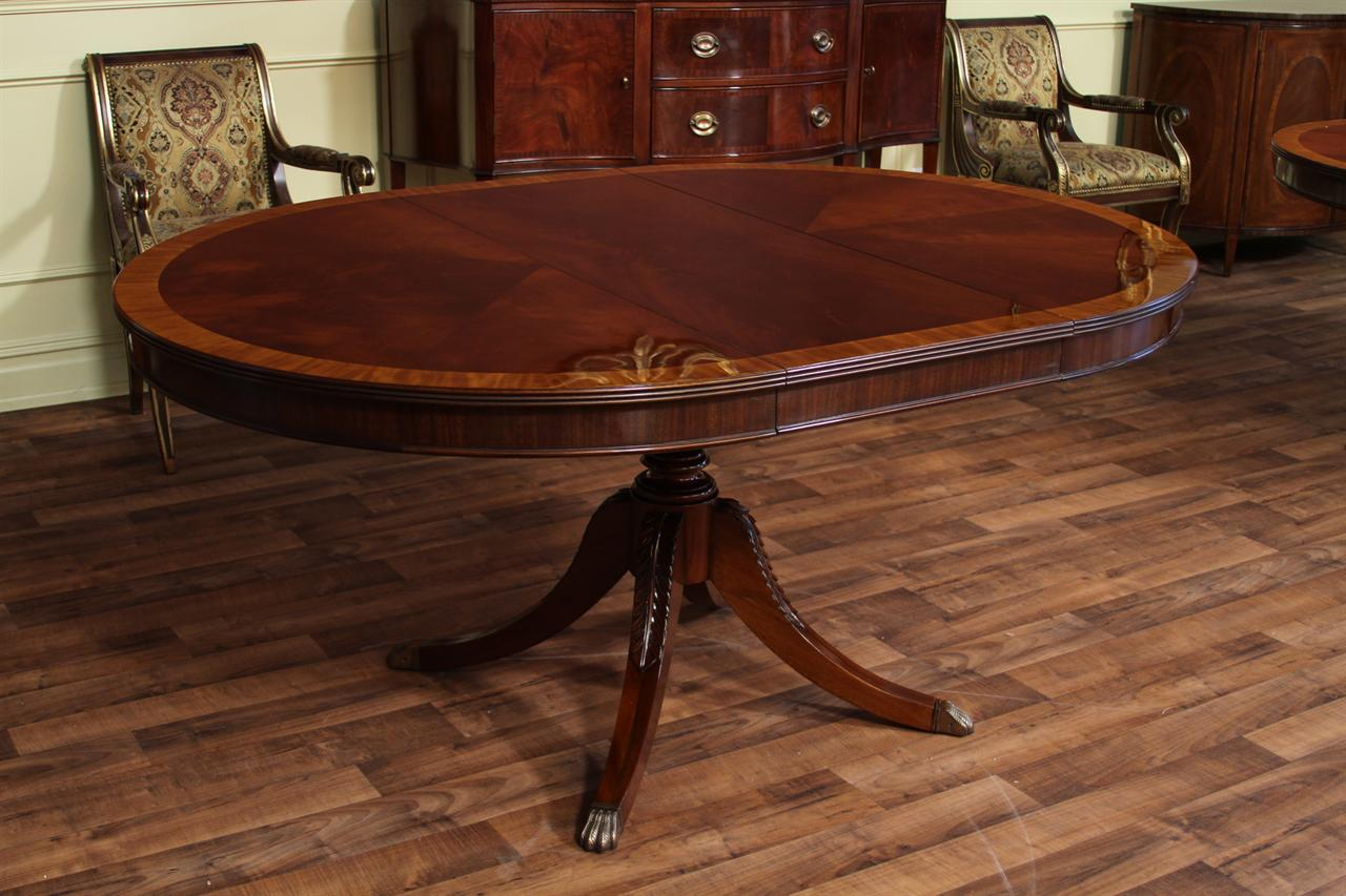 High End Mahogany Dining Table in a Walnut Finish 48 to 66 : 48 round to 66 oval dining table mahogany table with walnut finish 5611 from www.antiquepurveyor.com size 1280 x 853 jpeg 128kB