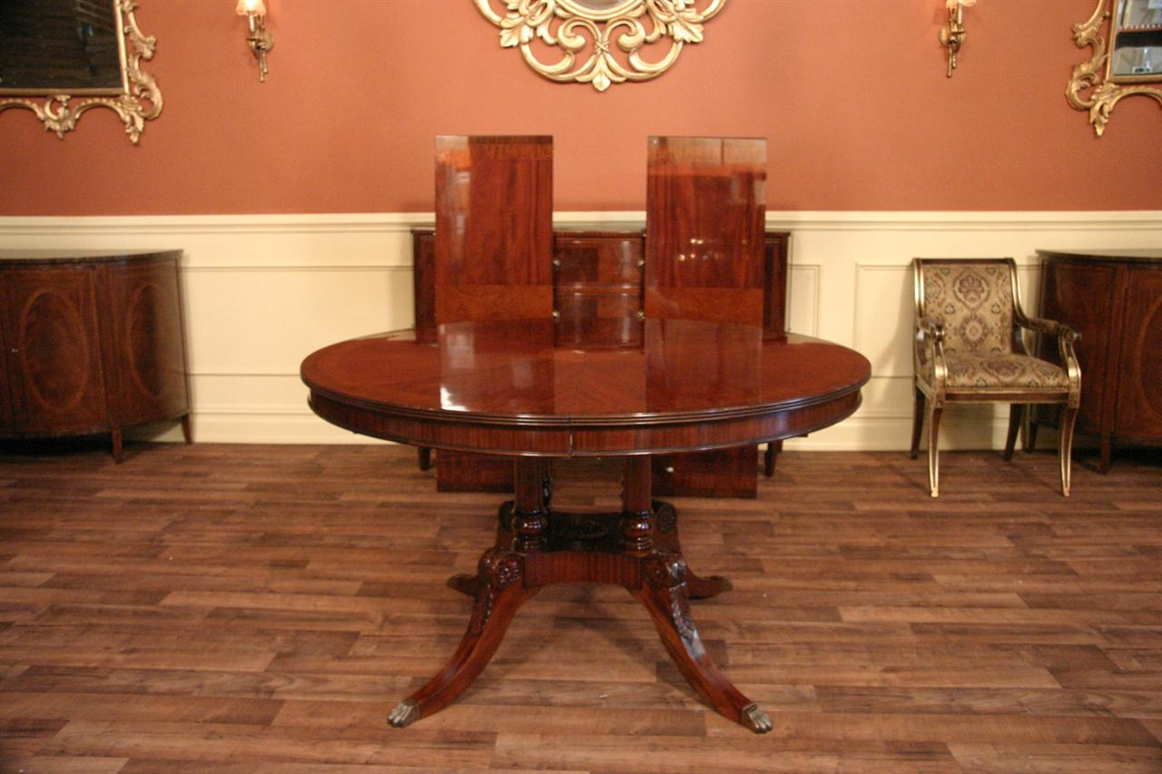 Mahogany finished 54 round dining table expands to 90 with 2 leaves