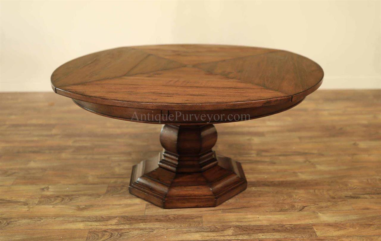 Rustic Expanding Round Table With Self Storing Leaves.Solid Walnut Table  With Turned Pedestal Base.