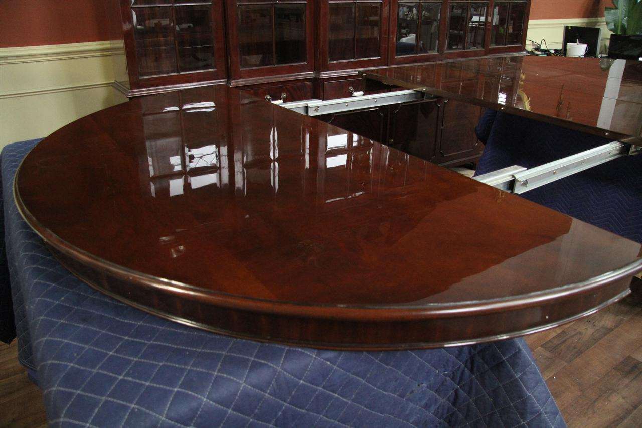 Round to oval round mahogany dining table with leaves for 10 seat round table