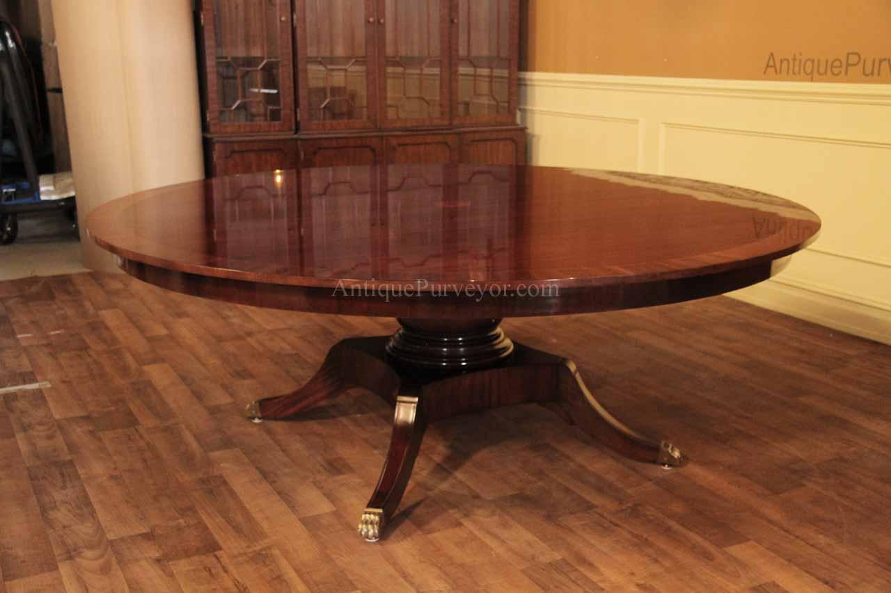 American Made And Classically Styled 84 Inch Round Mahogany Pedestal Table.