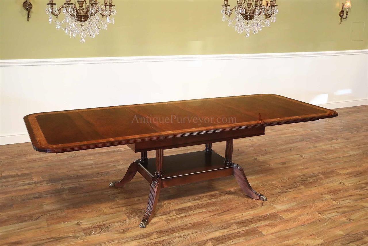 American made custom mahogany dining table with self storing leaves