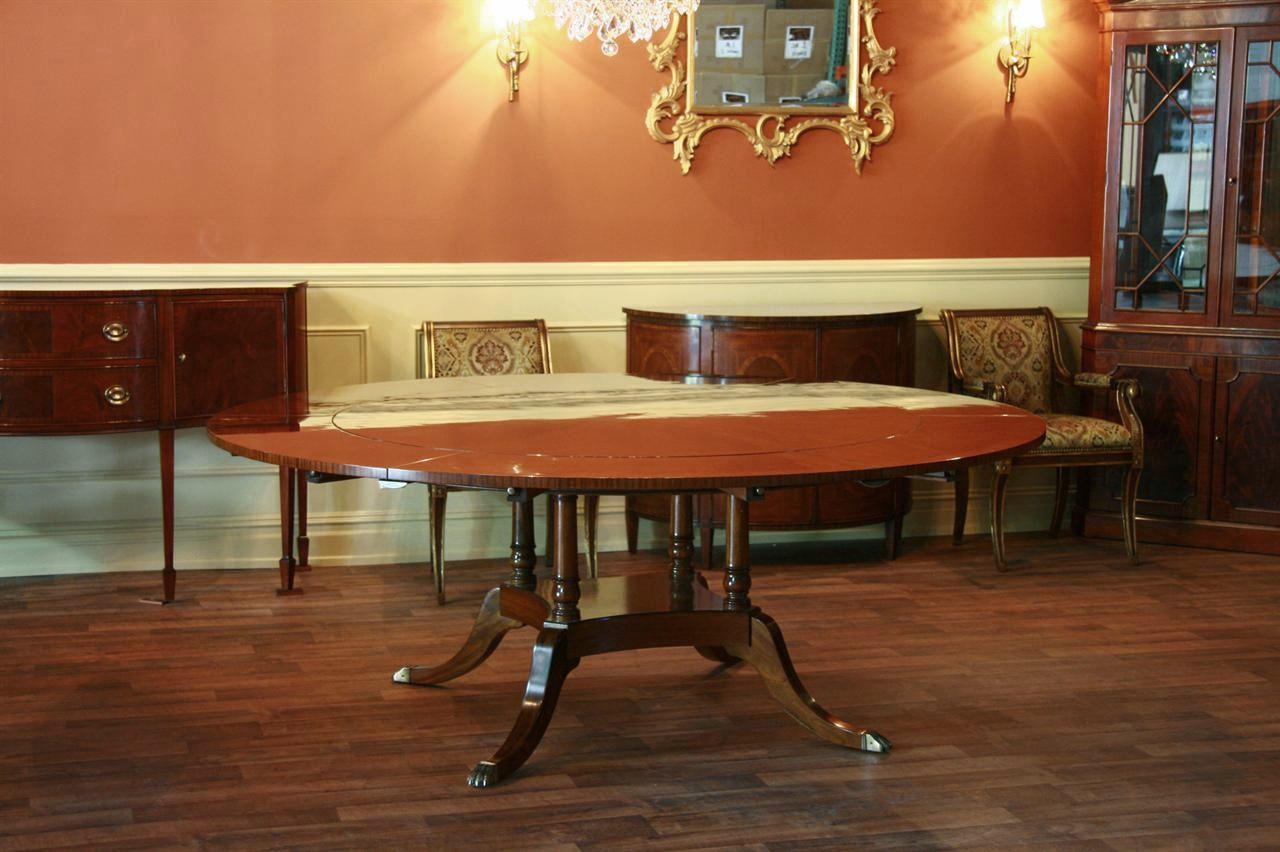 Round Expandable Dining Table Shown With All Leaves In Place And Seats 10  Persons