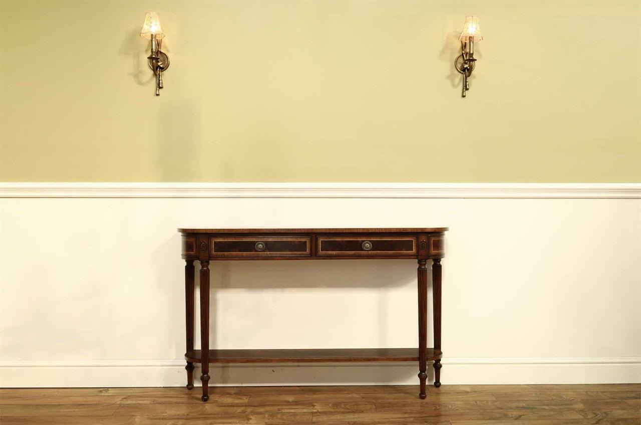 Banded mahogany console table with fluted legs and antiqued finish