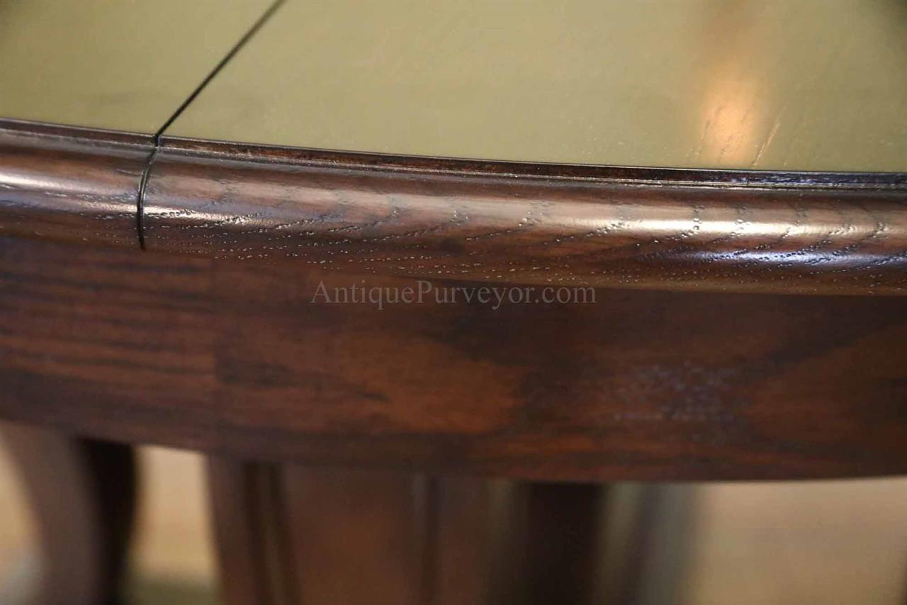 Transitional Black Oak Jupe Table With Self Storing Leaves