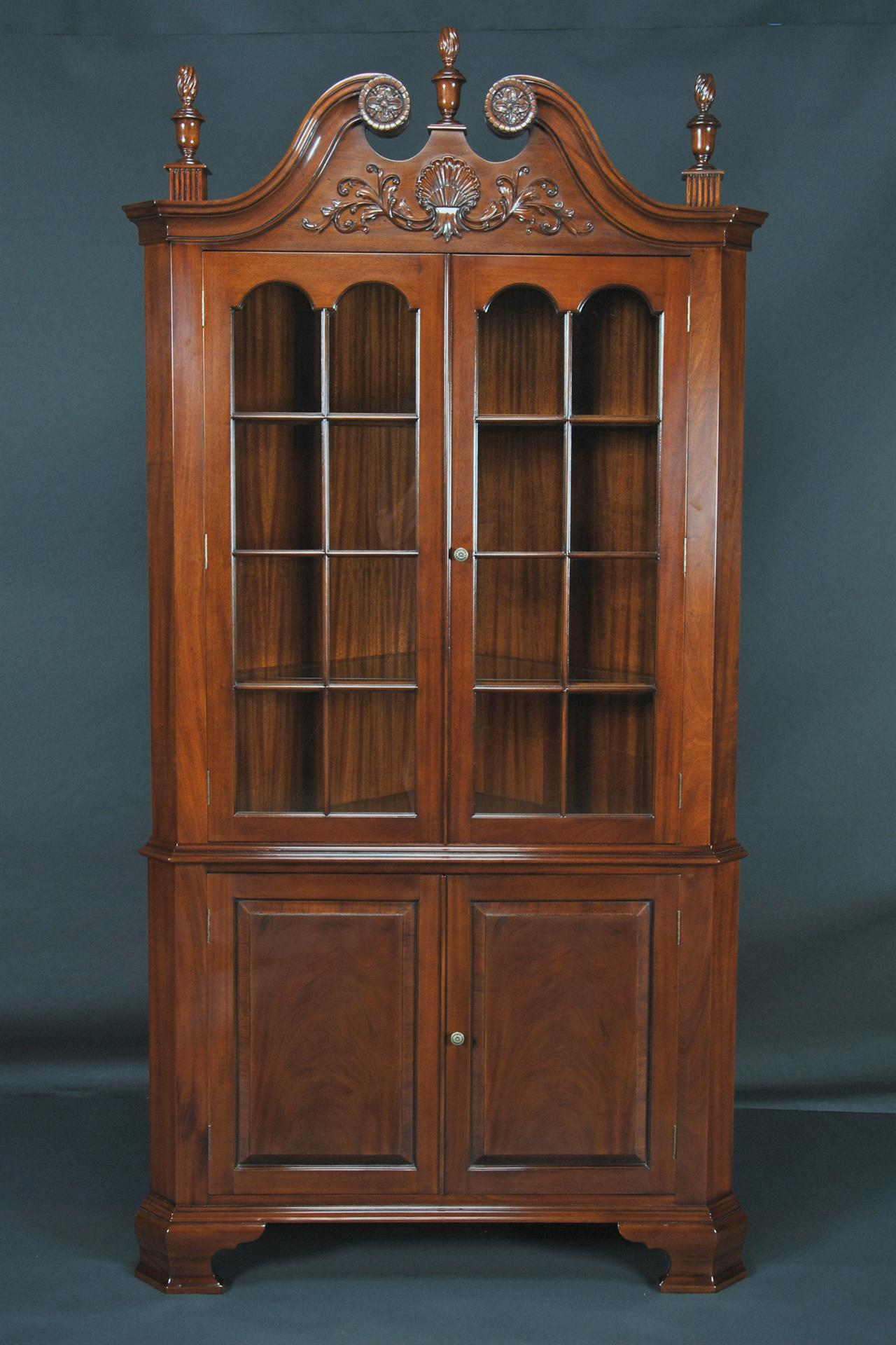 Colonial style corner cabinet with carved arch for Corner cabinet