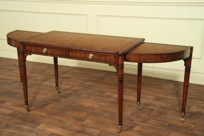 Expandable cerejeira writing desk with tapered legs and distressed finish.