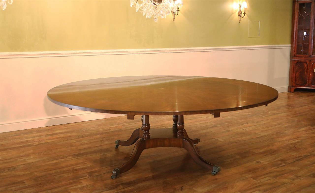 Expandable Round Dining Table. Expandable Round Mahogany Pedestal Table  With Perimeter Leaves And Star Inlay