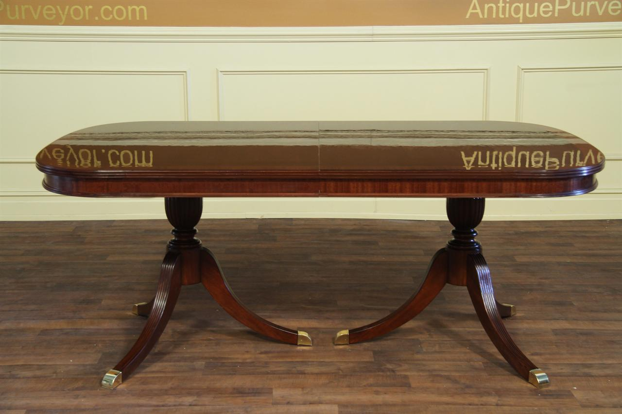 Fine mahogany dining table with two leaves opens to 10 feet for Traditional dining table