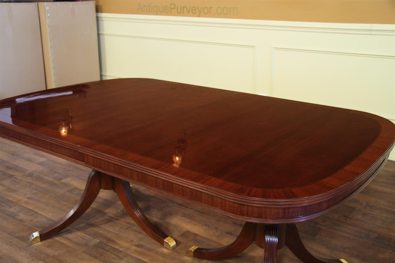 Formal double pedestal mahogany dining table with 2 leaves and