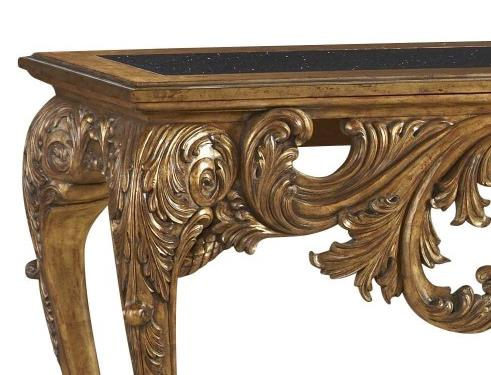 closeup of console table closeup of leaf carvings and gold detail