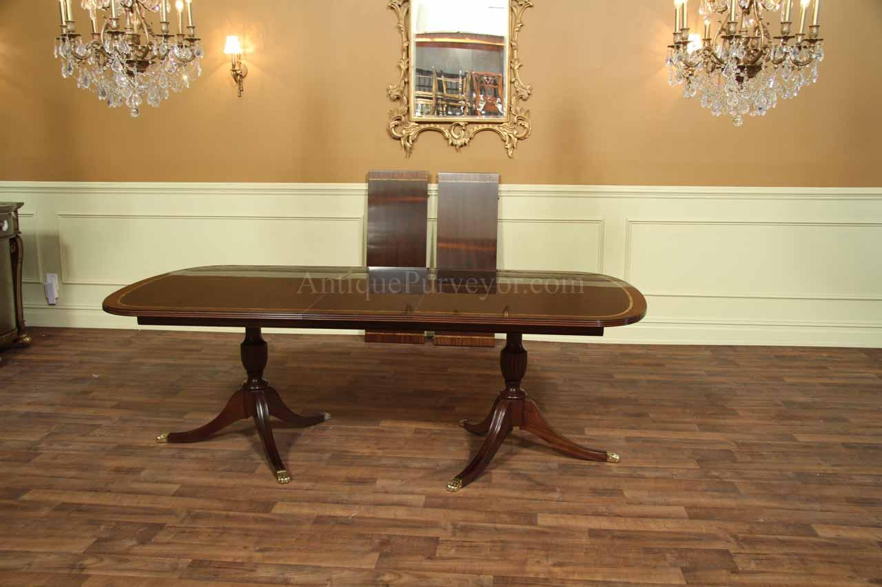 New formal american made double pedestal dining table with inlay henkel harris solid mahogany dining table shown with 1 leaf in place and two in background dzzzfo