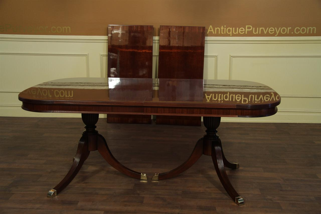 Fine mahogany dining table with two leaves opens to 10 feet for 10 foot long table