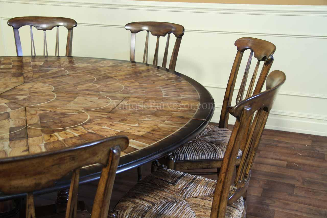 Round dining table and chair set shown with optional chairs & Solid Walnut | Oyster Inlaid Jupe Table | Ebony | Expandable