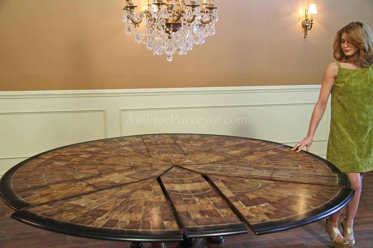 Expandable Round Dining Table Shown At 84 Inches. Slide Pie Cut Panels Back  Towards The Center Until Leaves And Panels Are Snug