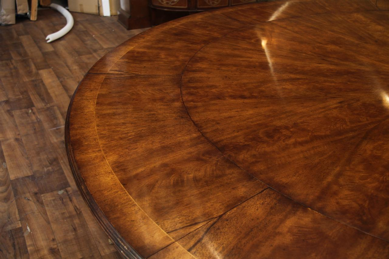 Fine High End Antique Reproduction With Steel Reinforced Saber Legs Expandable Round Walnut Dining Table