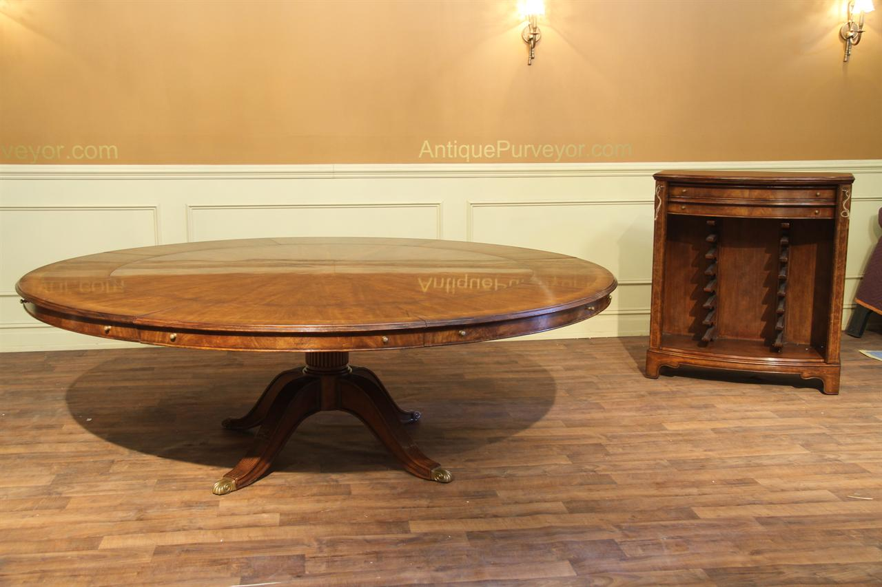 Large Round Expandable Walnut Dining Table And Buffet Leaf Storage