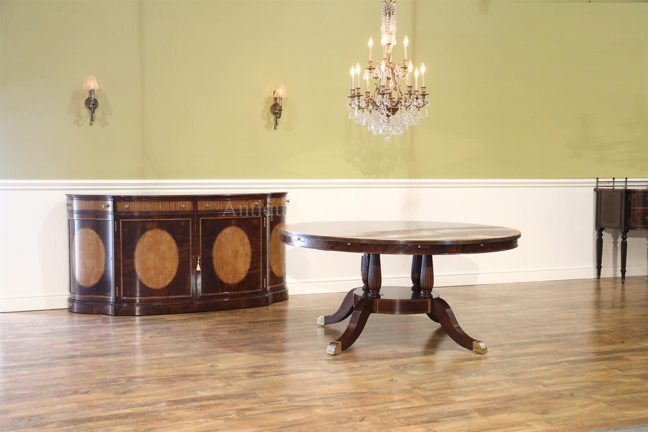 large round mahogany dining room table with perimeter