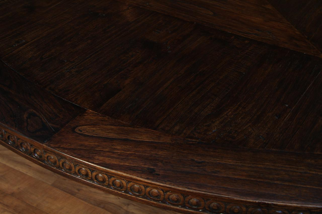 Rustic Solid Oak Table With Detailed Carving And Sturdy Base.