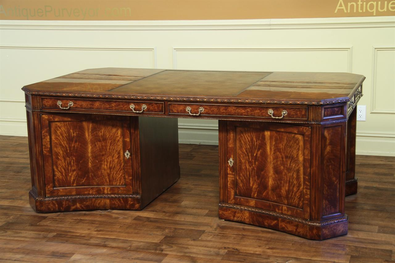 Fine reproduction partners desk with removable file cabinet/privacy panel.  Moves easily on castors.