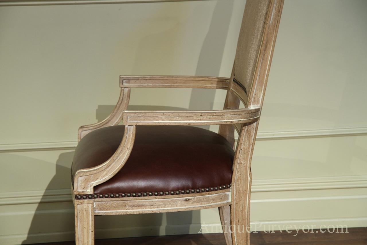 Leather upholstered dining chairs with natural wood finish for Natural wood dining chairs