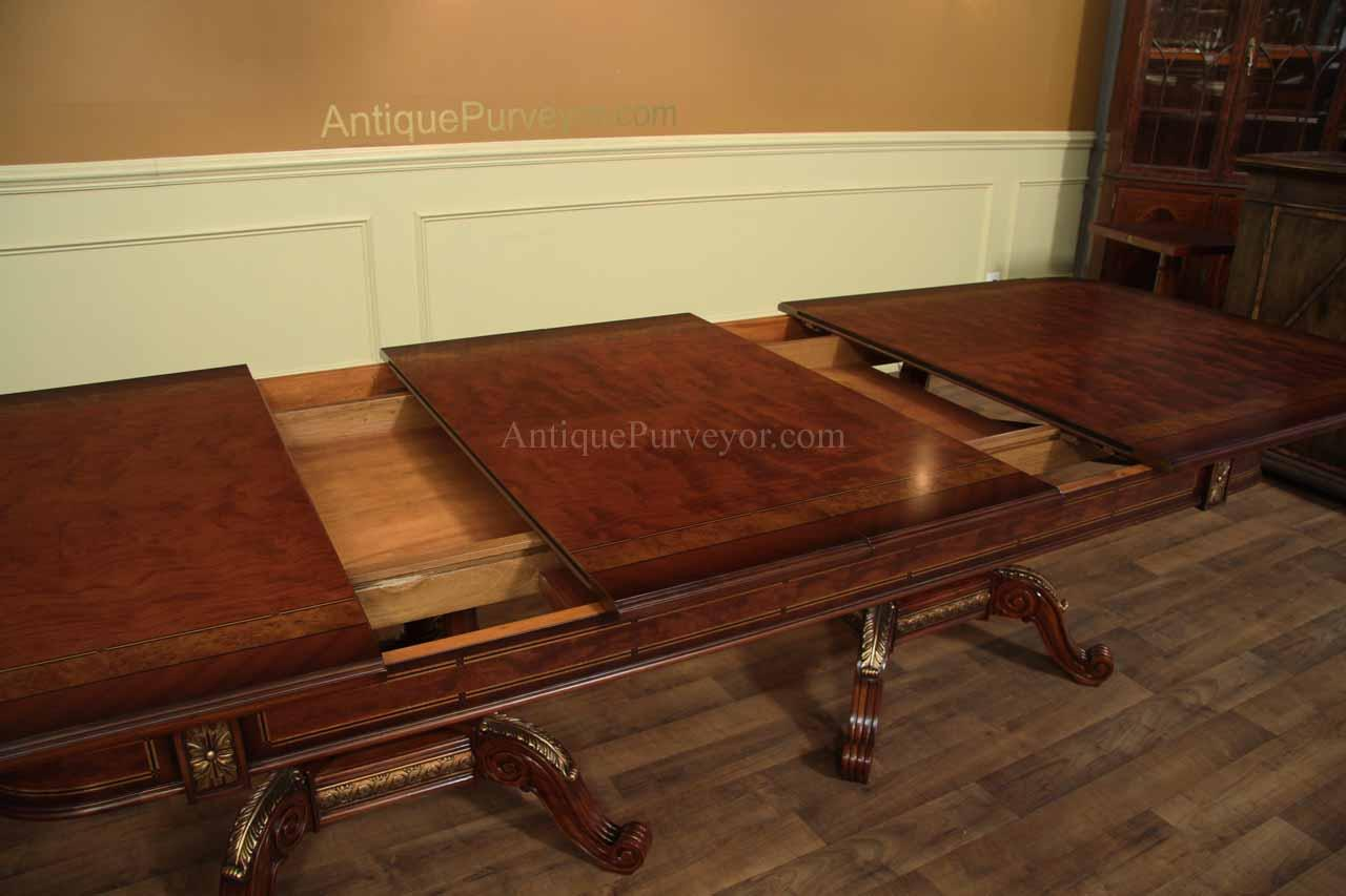 Mahogany and walnut dining room table with self storing for Dining room tables with leaves
