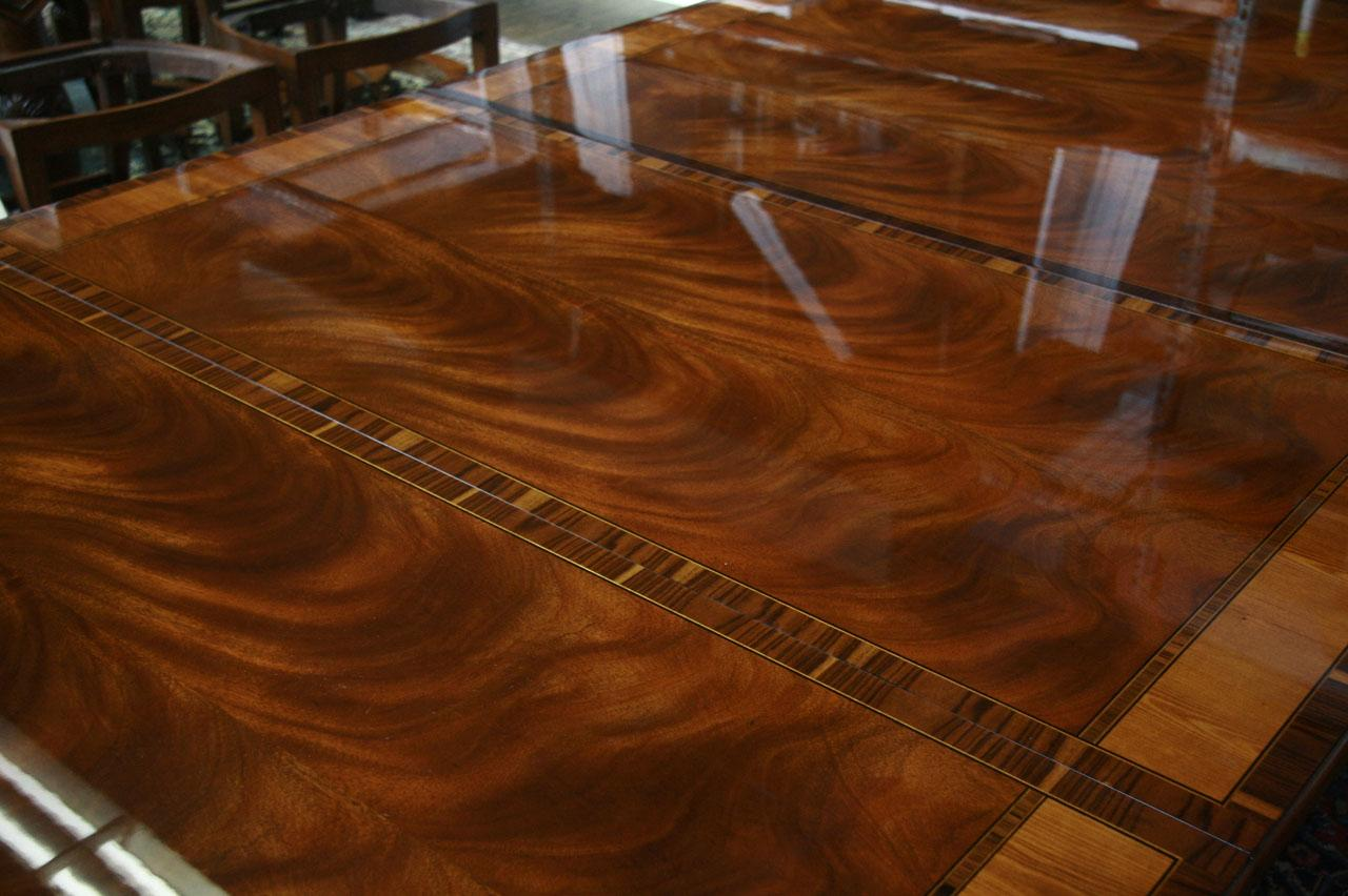 This cross banding on leaves makes it a masculine conference room table. Reproduction French Style Mahogany Dining or Conference Table