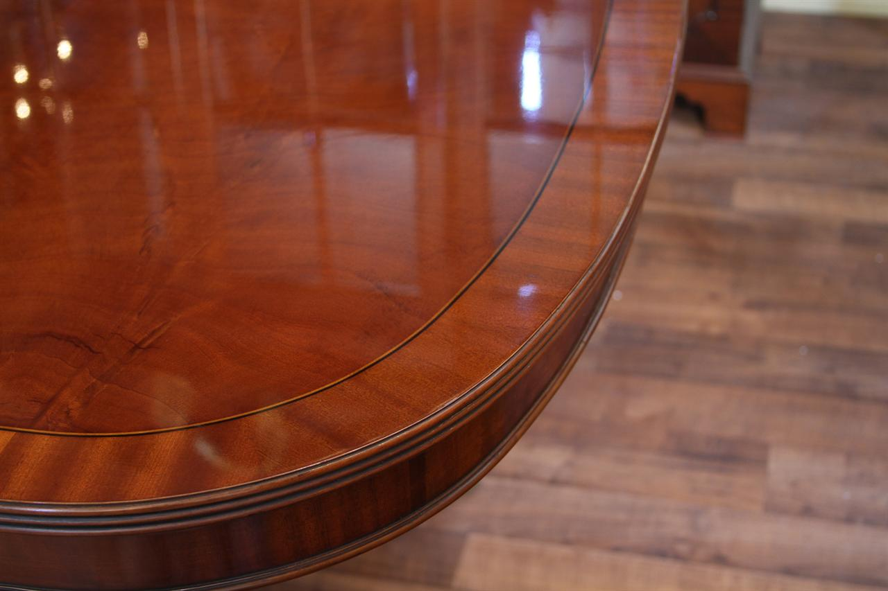 Straight grain and ribbon mahogany banding on mahogany dining room table