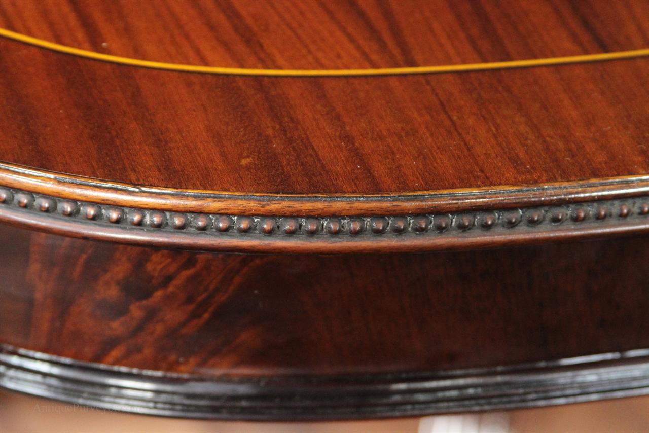 Flame mahogany apron details, fine carvings on tables edge shown here
