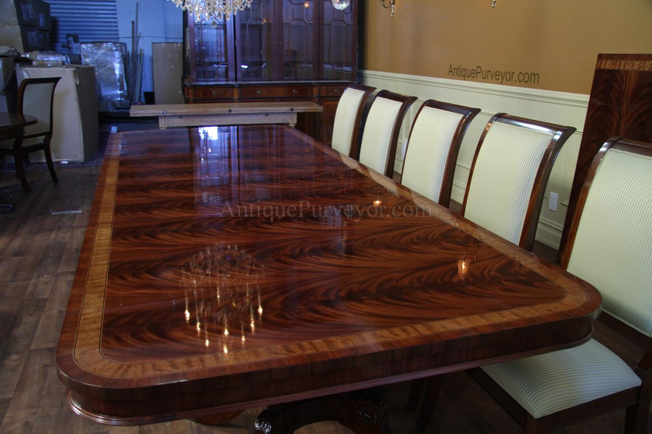 Long Mahogany Dining Table Shown In Moderate Lighting