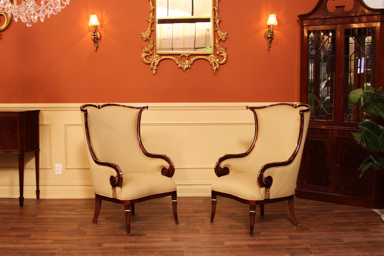 High end gold leaf accented fireside chairs