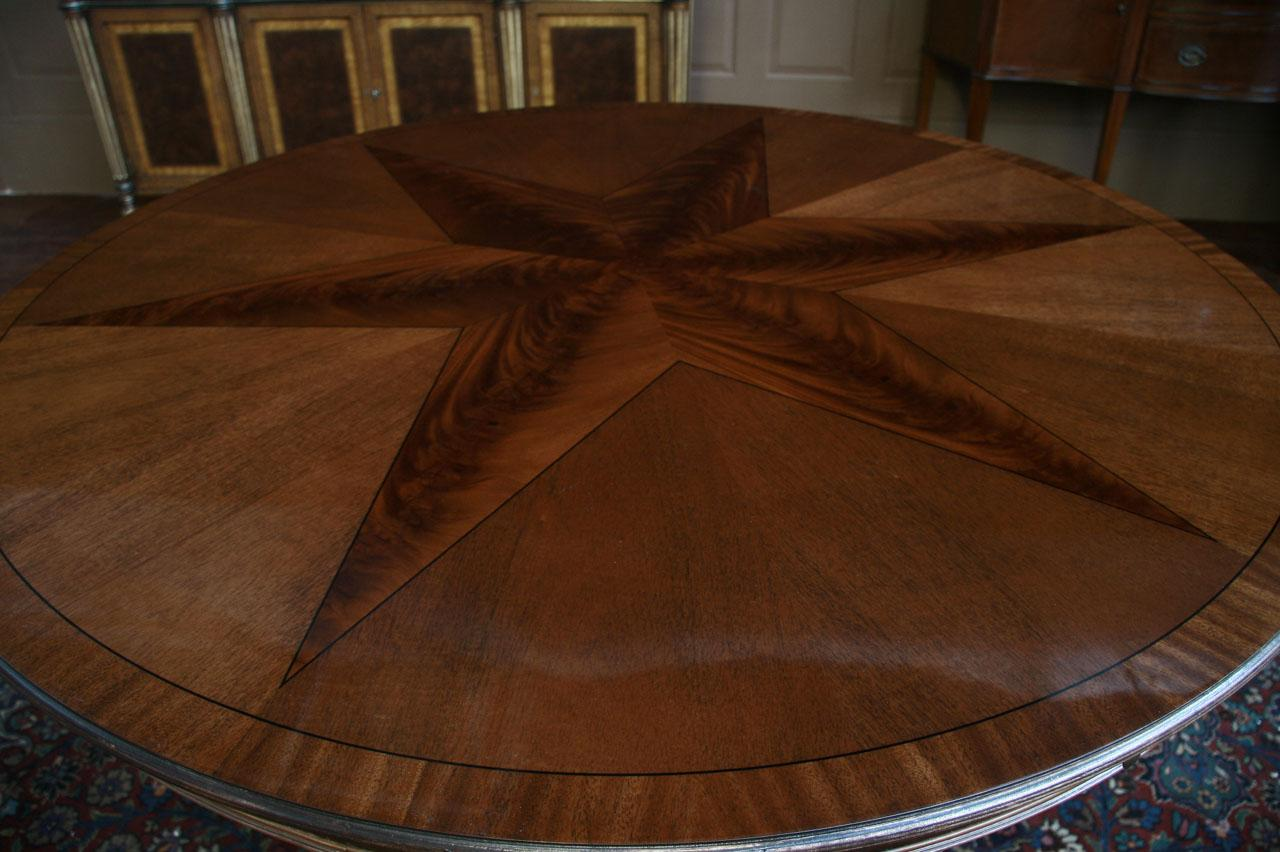 round mahogany dining table with leaves. antique reproduction