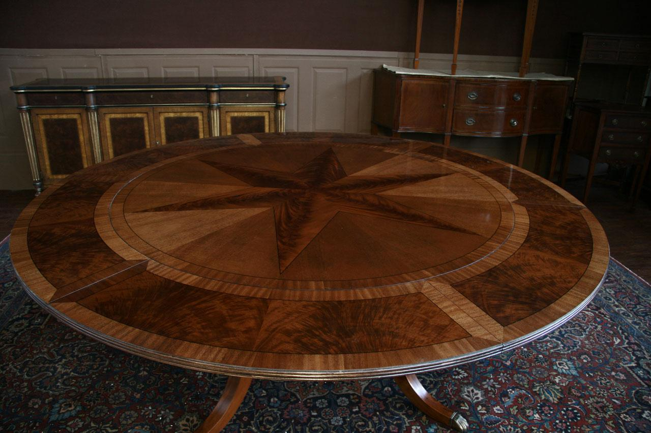 Merveilleux Round Mahogany Dining Table Shown With Leaves, Seats 10 People.