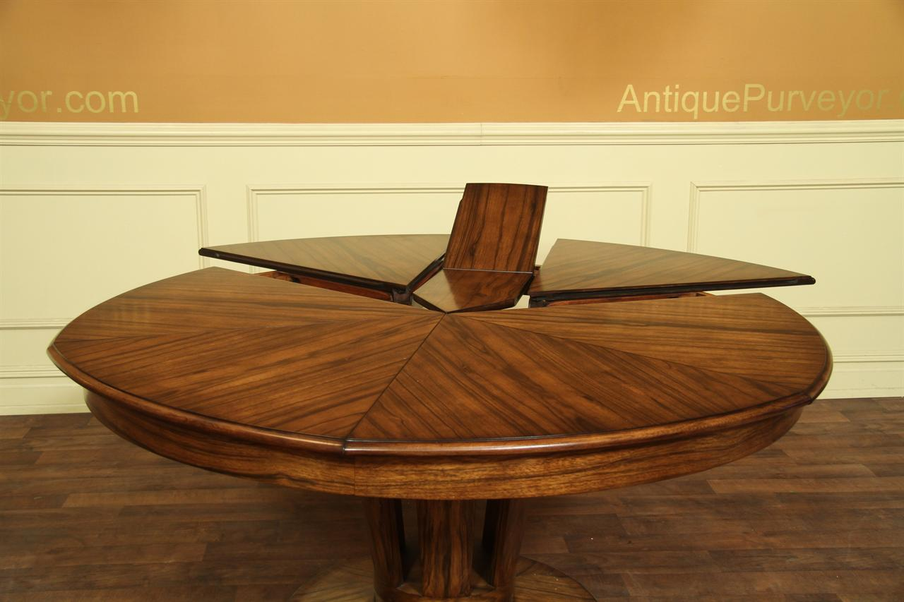 Contemporary Expandable Round Dining Table With Self Storing Leaves