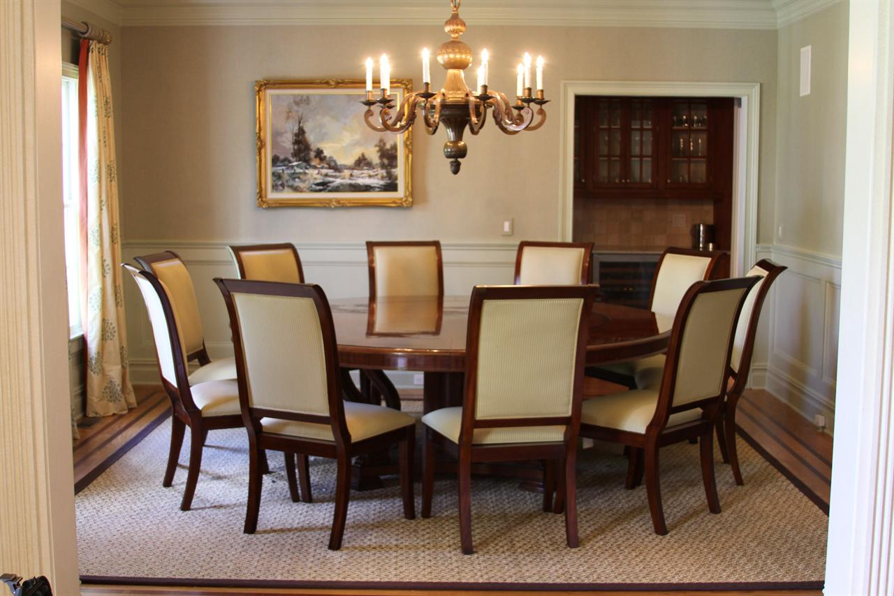 upholstered dining chairs shown with extra large round mahogany dining table . extra large  round mahogany dining table with perimeter leaves