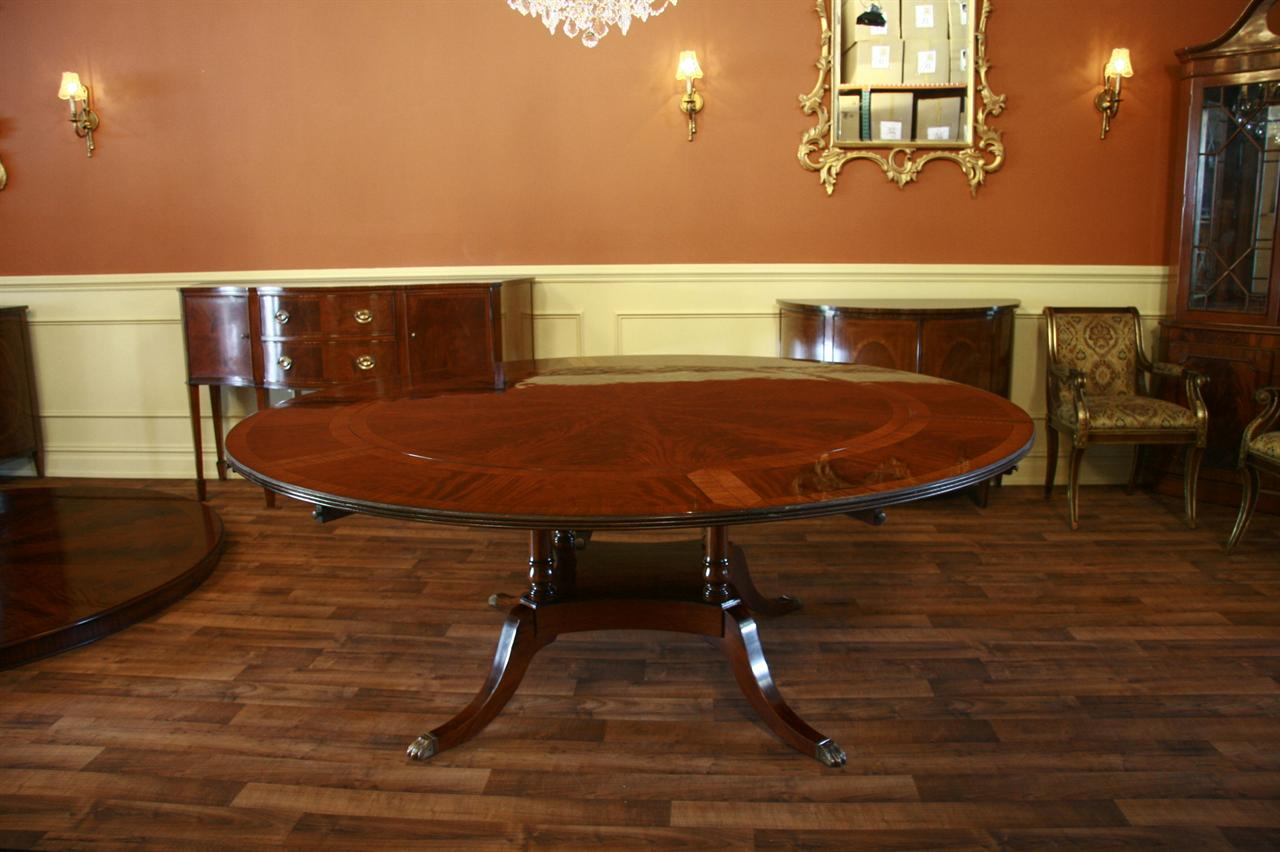 High end round mahogany dining table with extensions