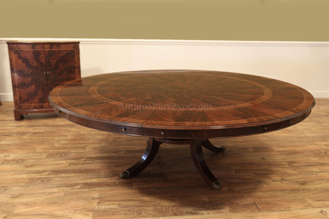 Round exapandable dining room table with leaf storage cabinet