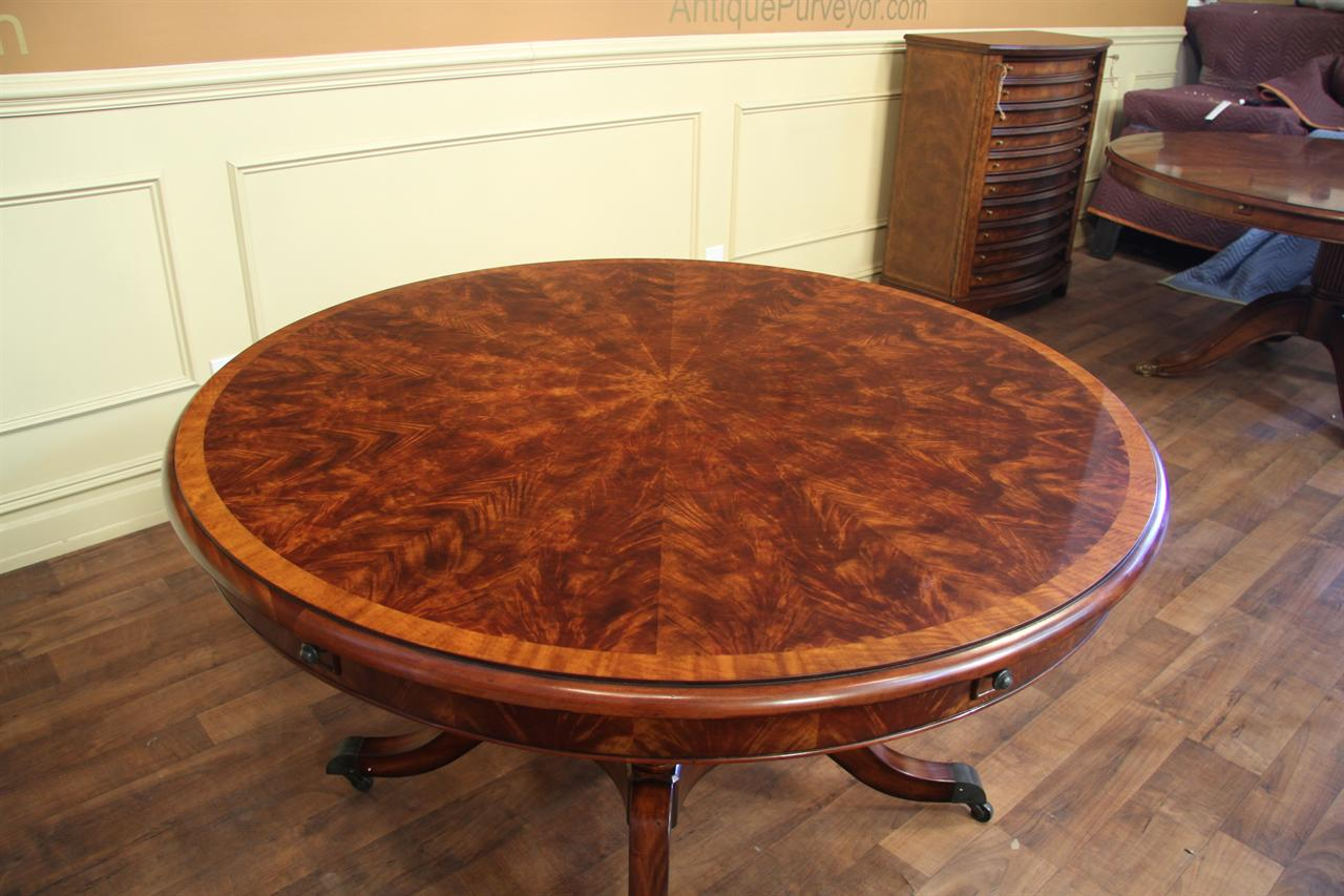 Round expandable formal mahogany dining table with leaves for Fancy round dining table
