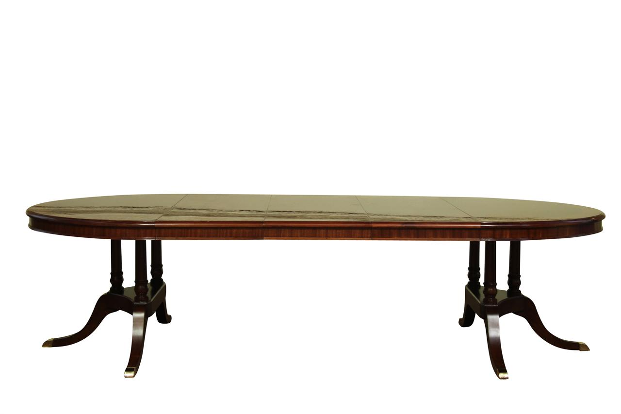 Round to oval mahogany dining table with leaves sits 12 for Table with that left
