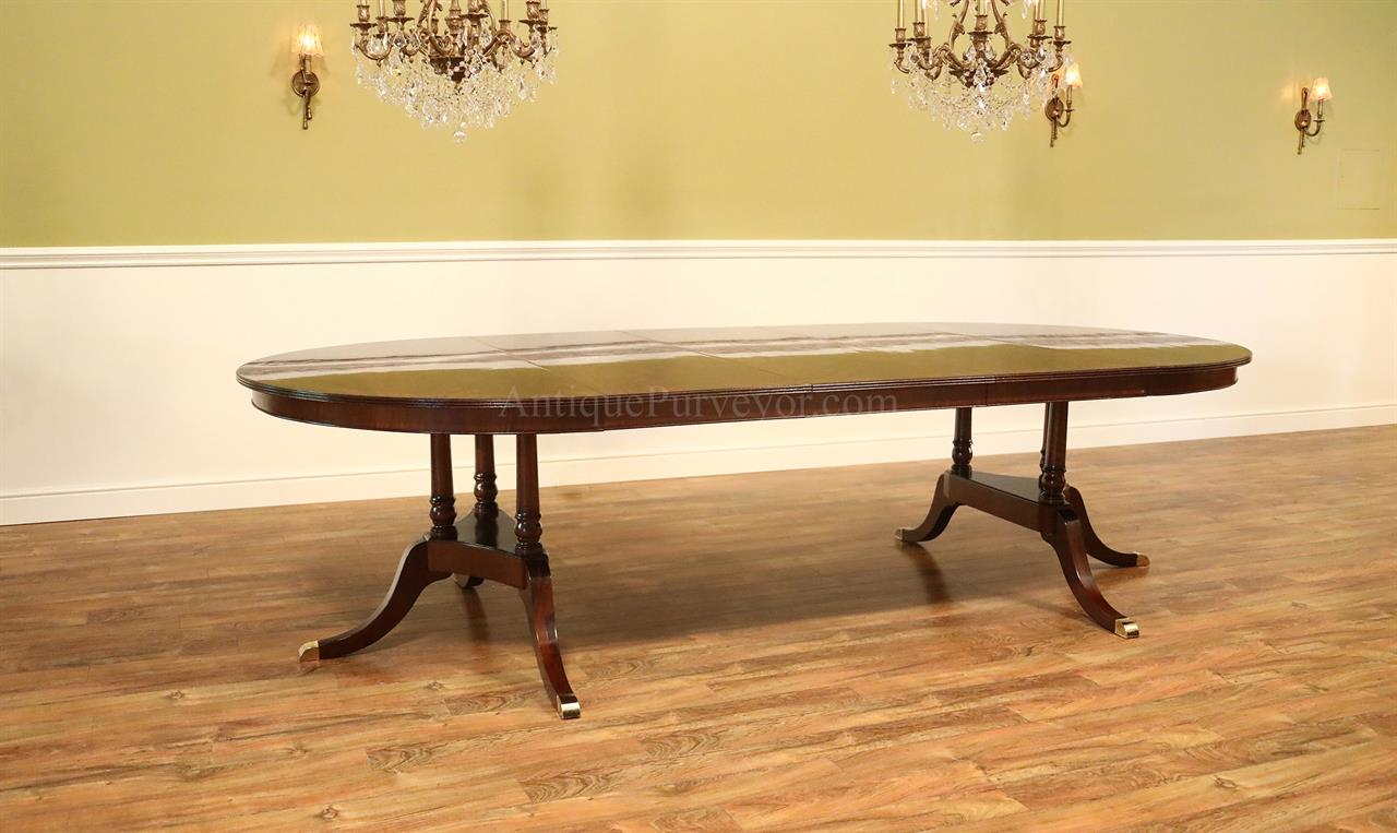 Heirloom mahogany round to oval dining table