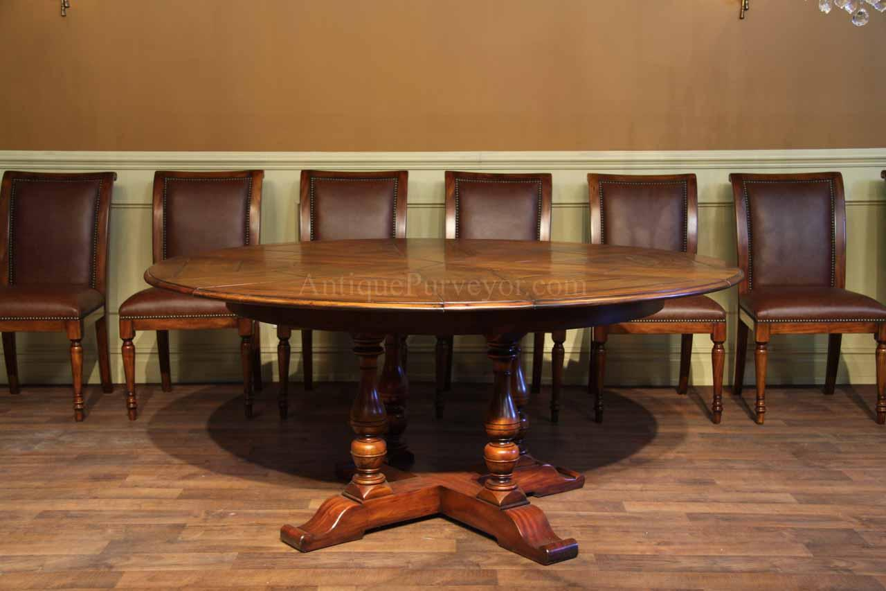 Round Solid Walnut Round Dining Table With HIdden Leaves - Walnut color dining table