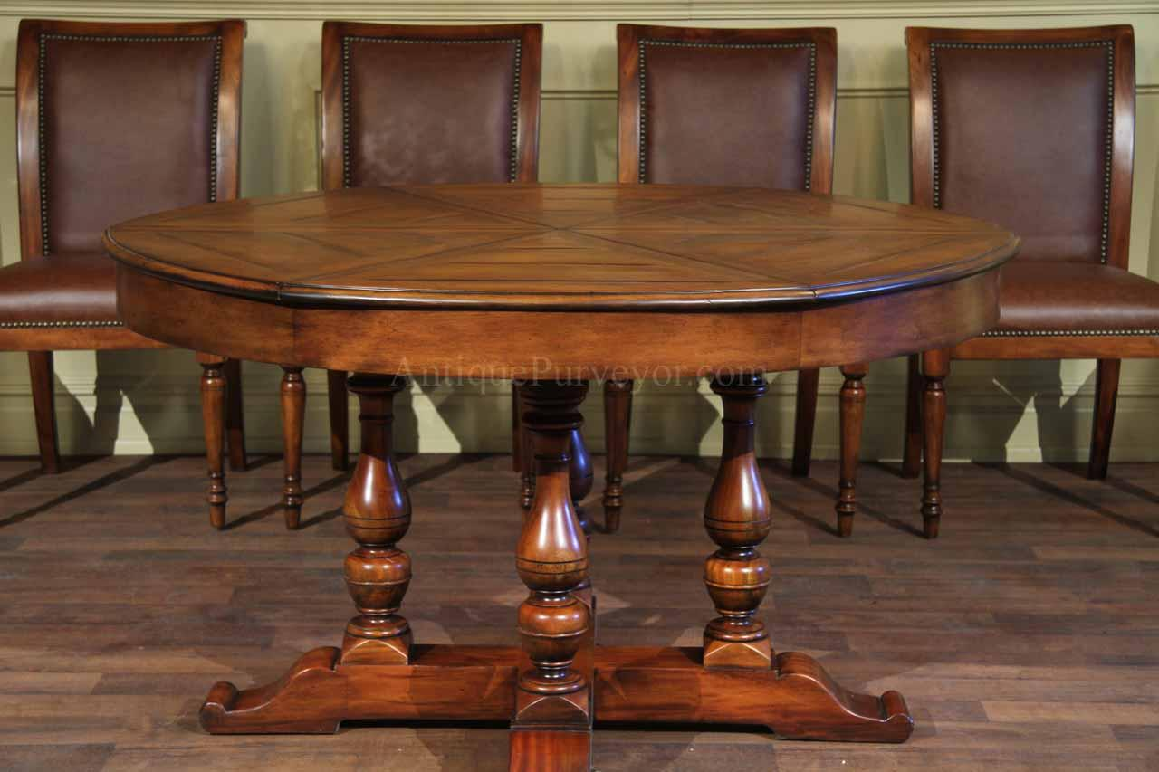 Round dining table with hidden leaves solid walnut for Solid wood round dining room table