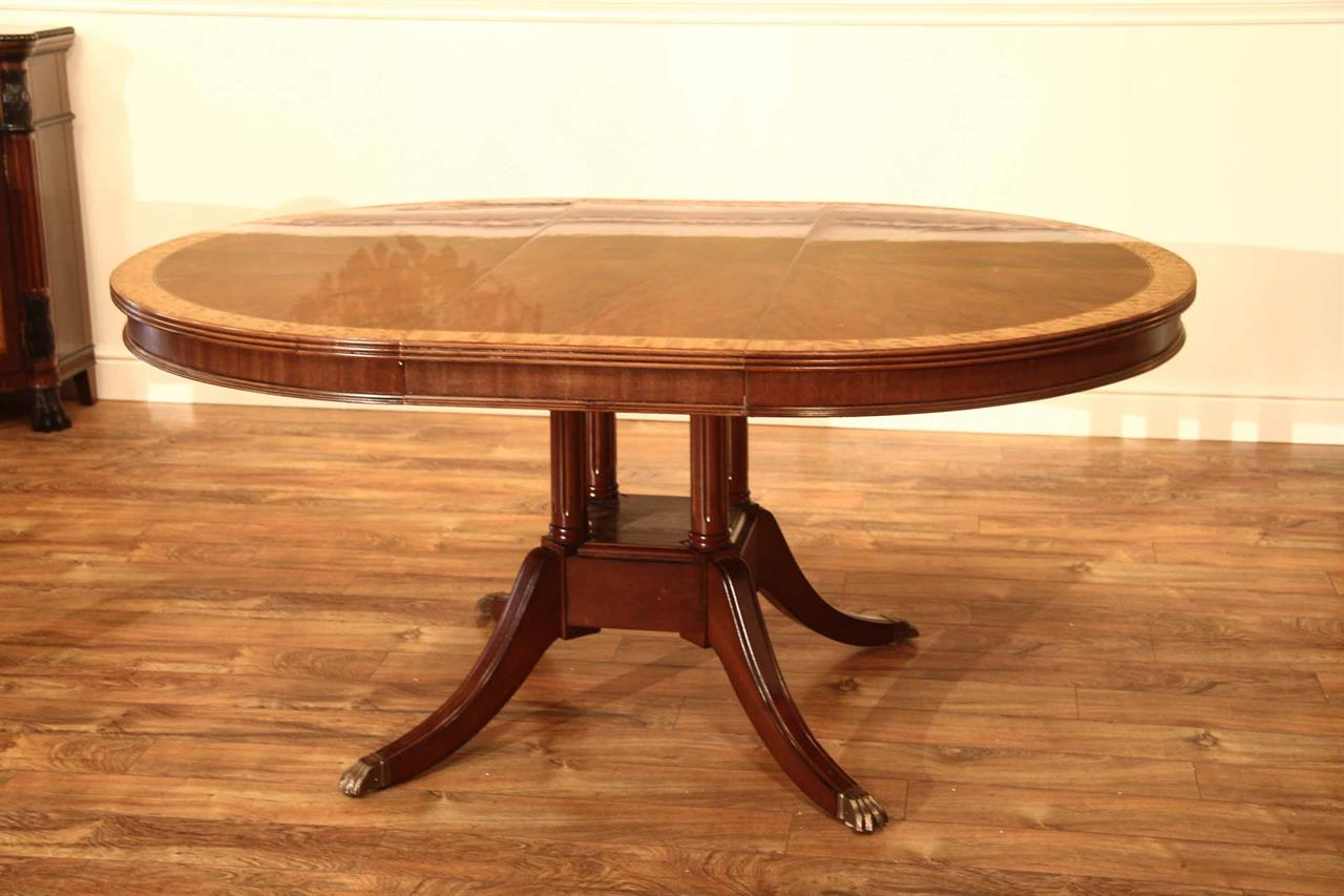 Small 48 in Round Mahogany Dining Table with Leaf