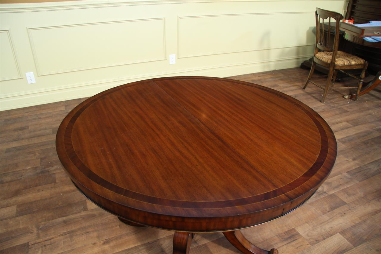 small round mahogany dining table with leaf