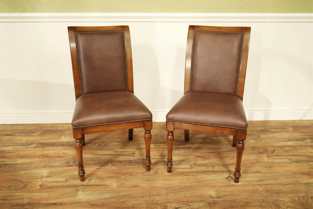 Solid Walnut And Leather Upholstered Dining Chairs With Brass Tacks