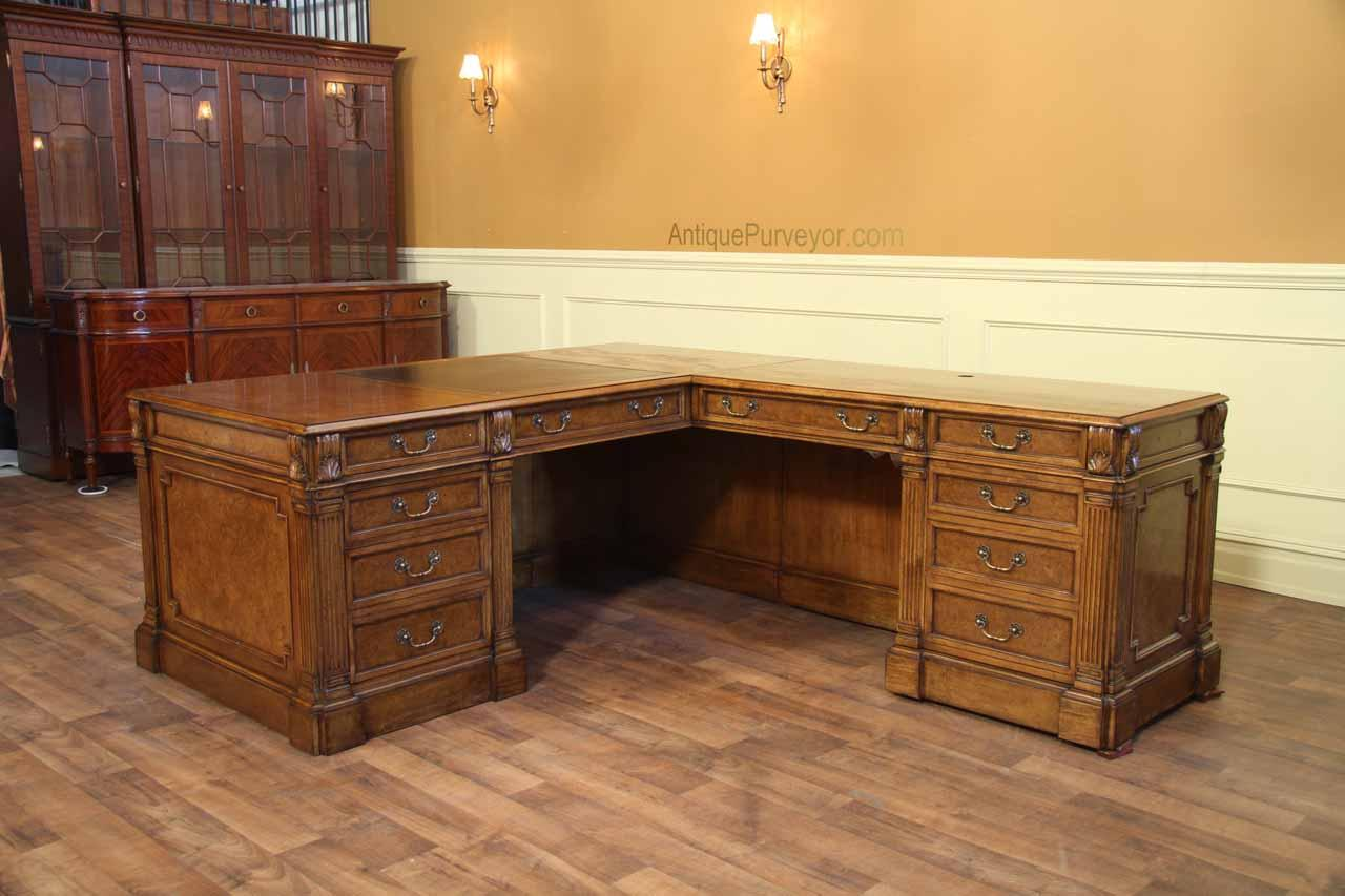 Traditional walnut L shape desk with leather top.