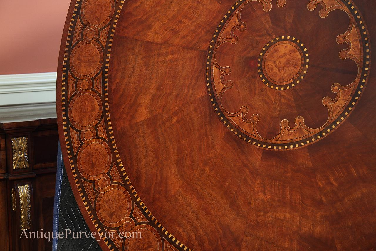 60 in mahogany and walnut burl dining table with pedestal base.